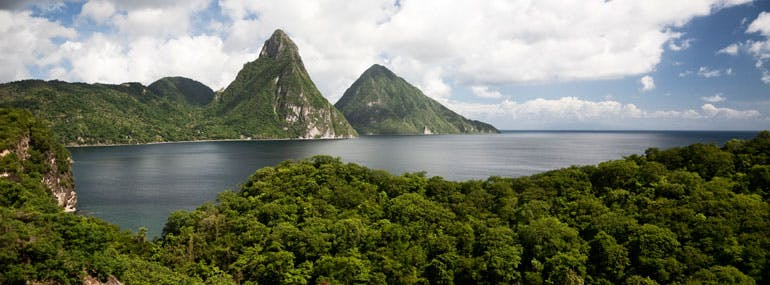 Which island is famous for the Pitons?