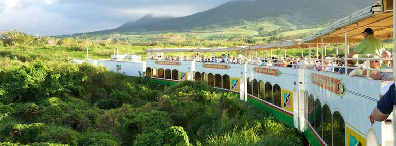 Which island has a sightseeing train that once transported sugar?