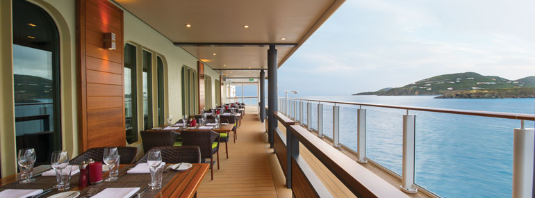 Where can you find this outdoor space where cruisers enjoy their evening meal with a view as they sail out of port?