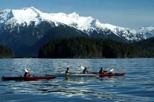 kayakers alaska anchorage lake with mountains