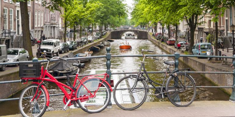 bicycles bridge canal amsterdam netherlands activities